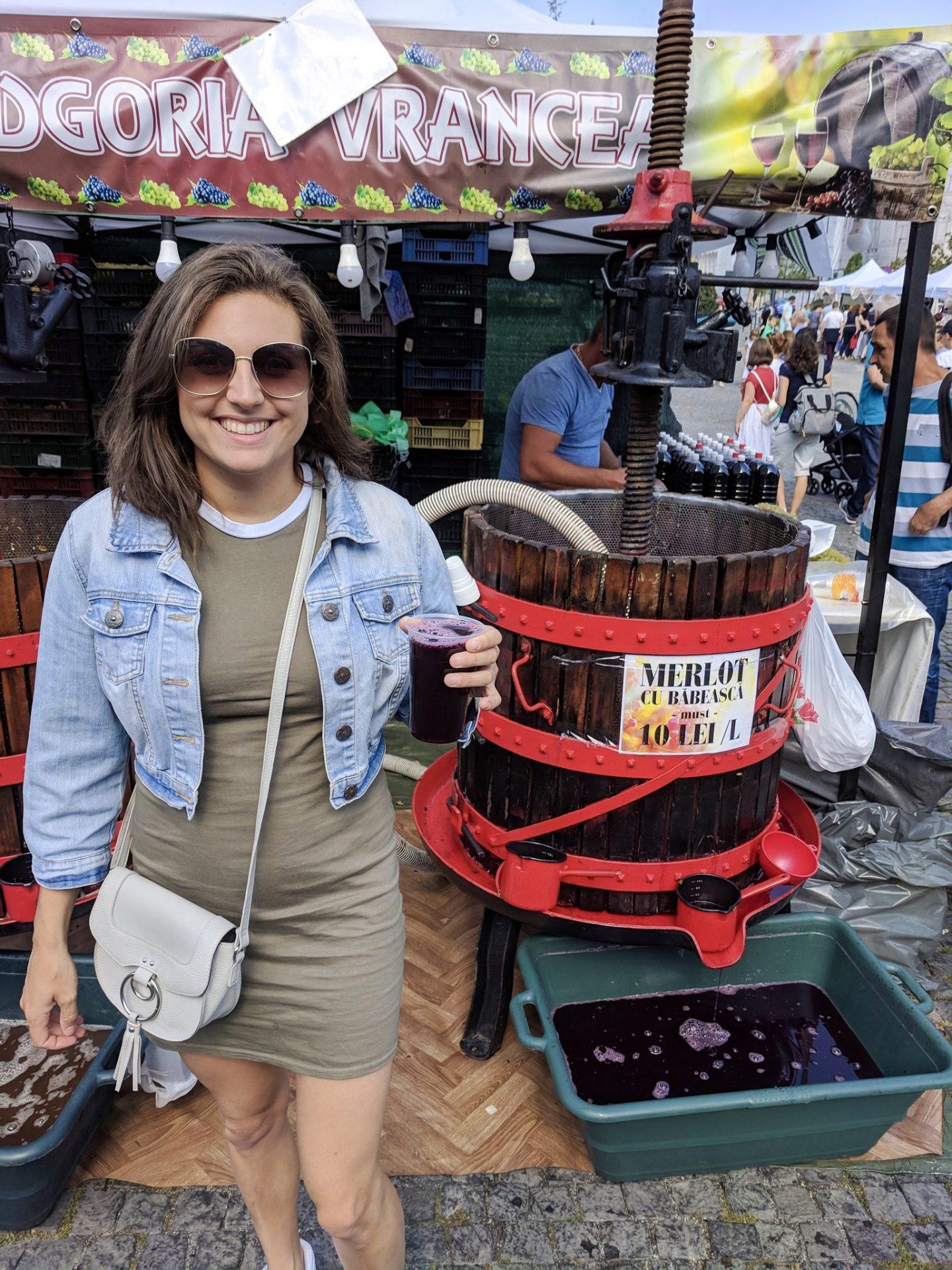 Girl in front of barrel of wine in Eastern Europe