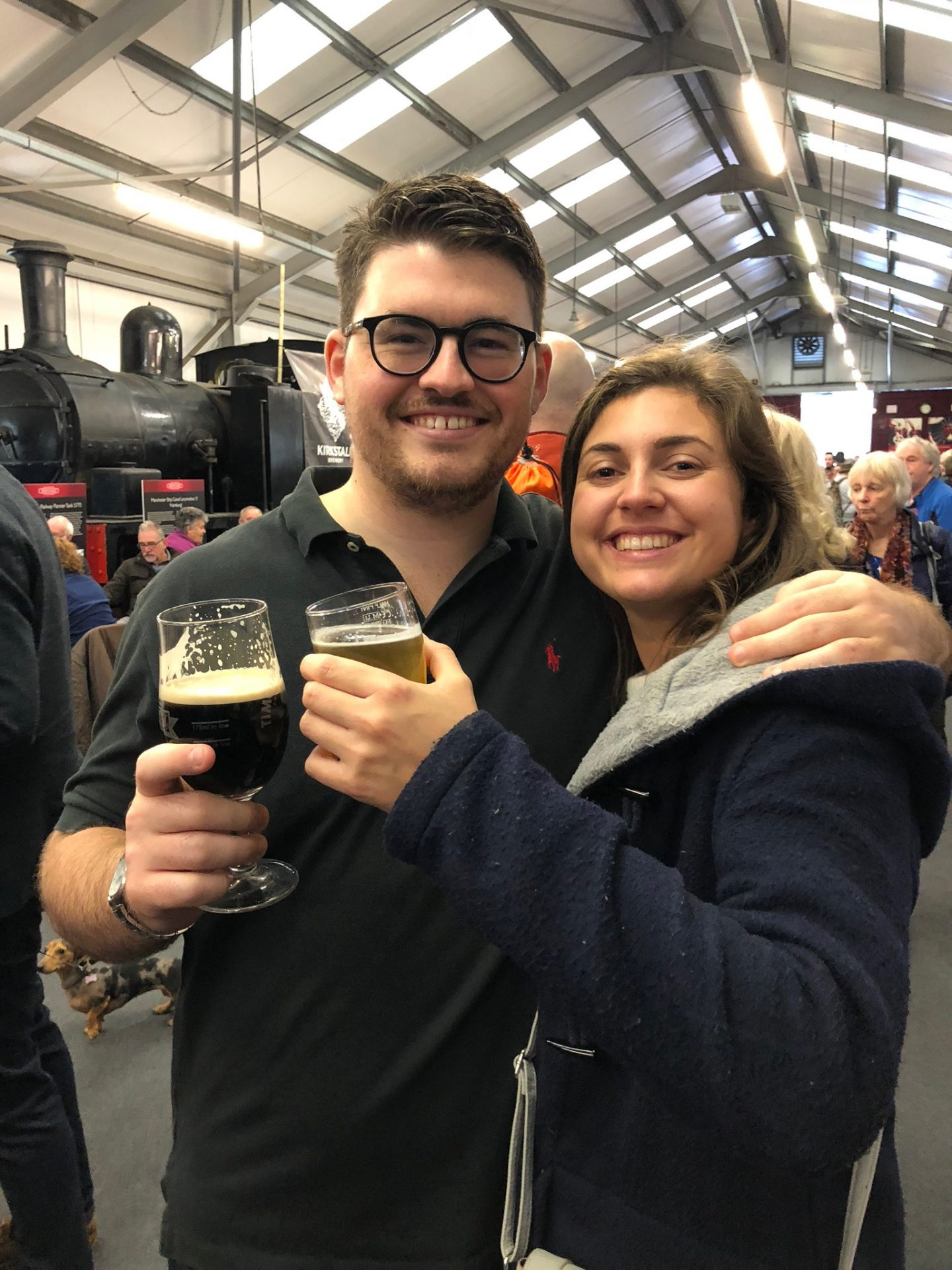 Man and women with a beer each at the KWVR beer festival