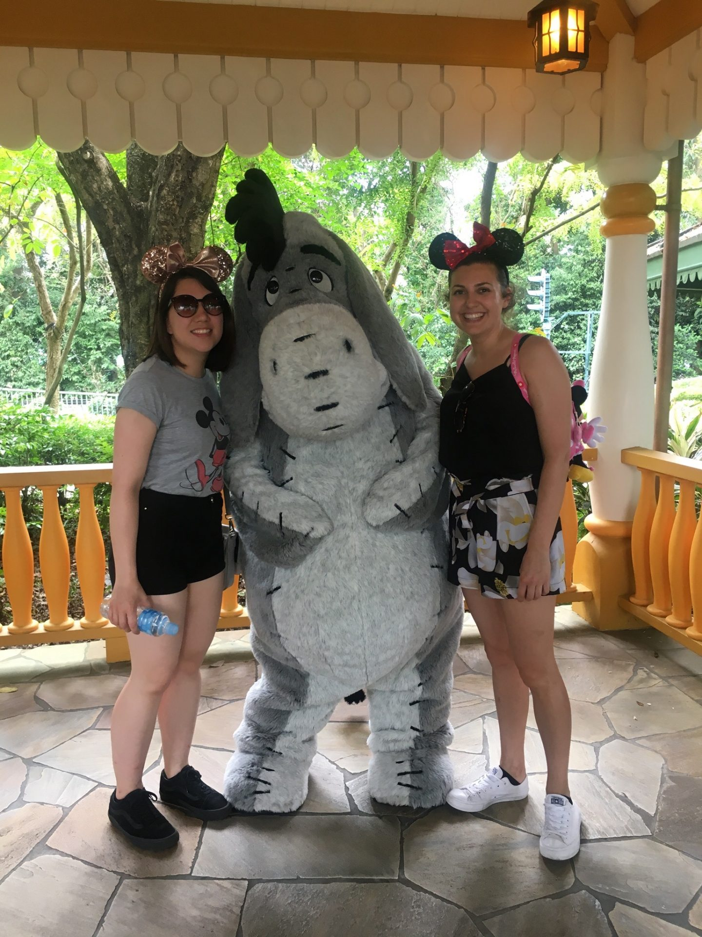 things to do in hong kon: two girls posing with eeyore character