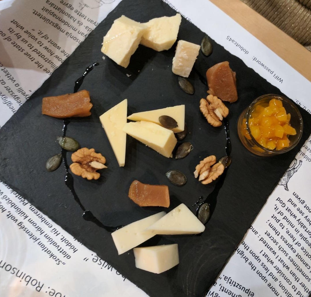 A beautifully presented cheeseboard with quince jelly and walnuts