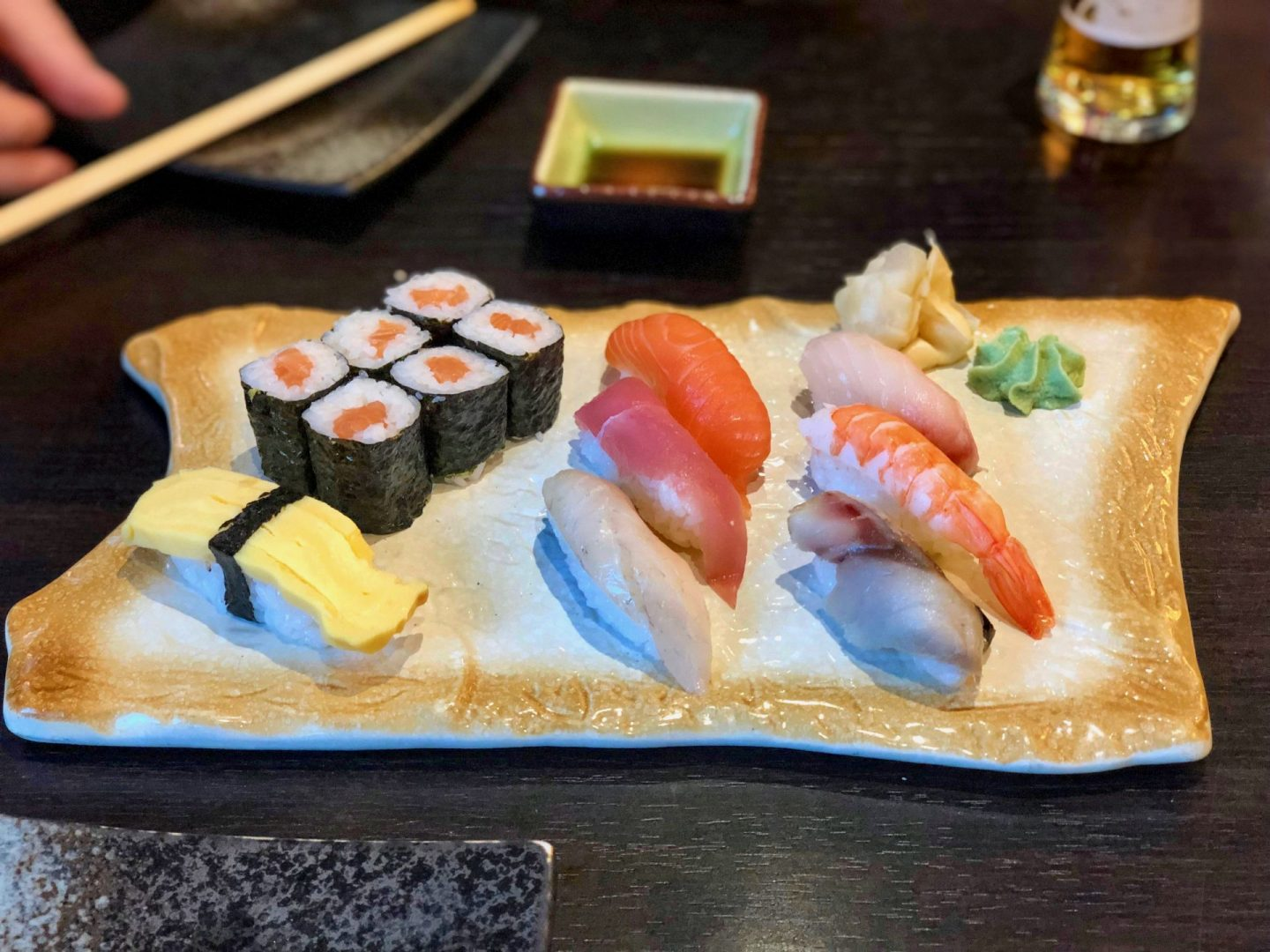 A platter of sushi in leeds showing different types of nigir and salmon maki