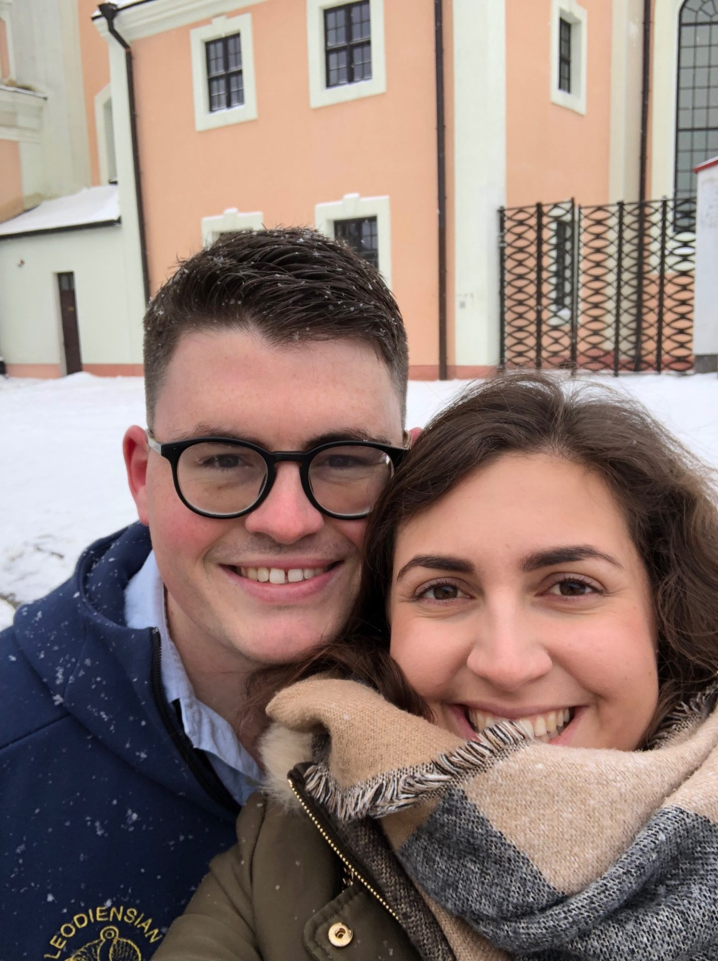 Selfie of Nell and Billy in Vilnius, surrounded by snow and smiling at the camera with rosy cheeks.