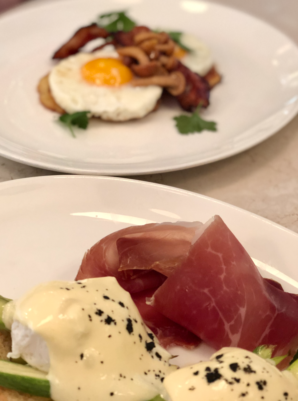 Best restaurants in Vilnius: Eggs Benedict at Sugamour, on a plate and taken as a close up.