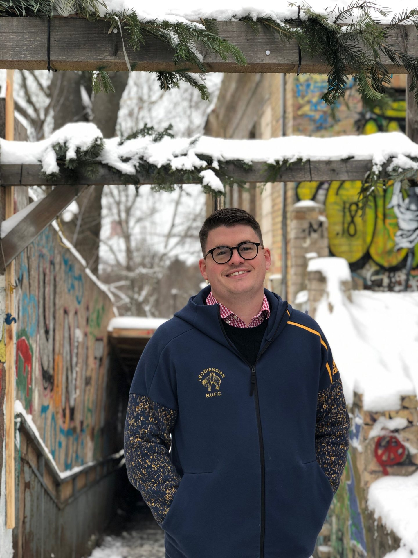 things to do in vilnius in winter: Billy in uzepis enjoying some street art and smiling at the camera