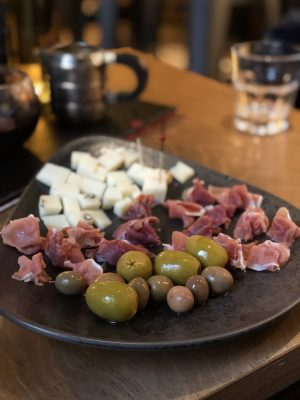 vilnius bars: a platter of cheese, ham and olives