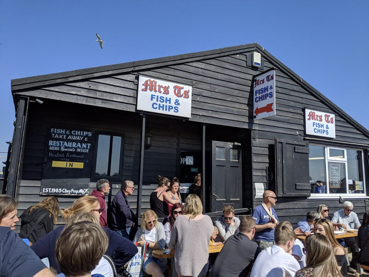 Things to do in Southwold: outside Mrs T's fish and chip shop, packed with people on benches