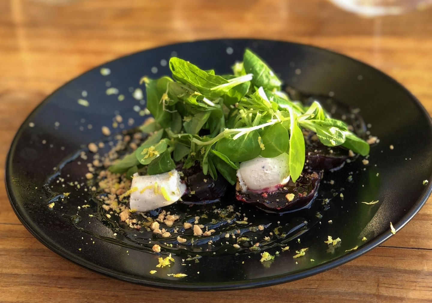 Beetroot and goats cheese on a black plate in Gran Canaria