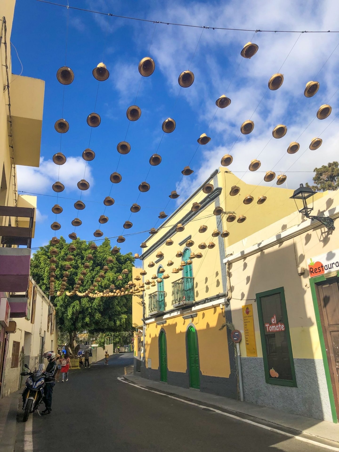 A street in Gran Canaria where hats hang over the road