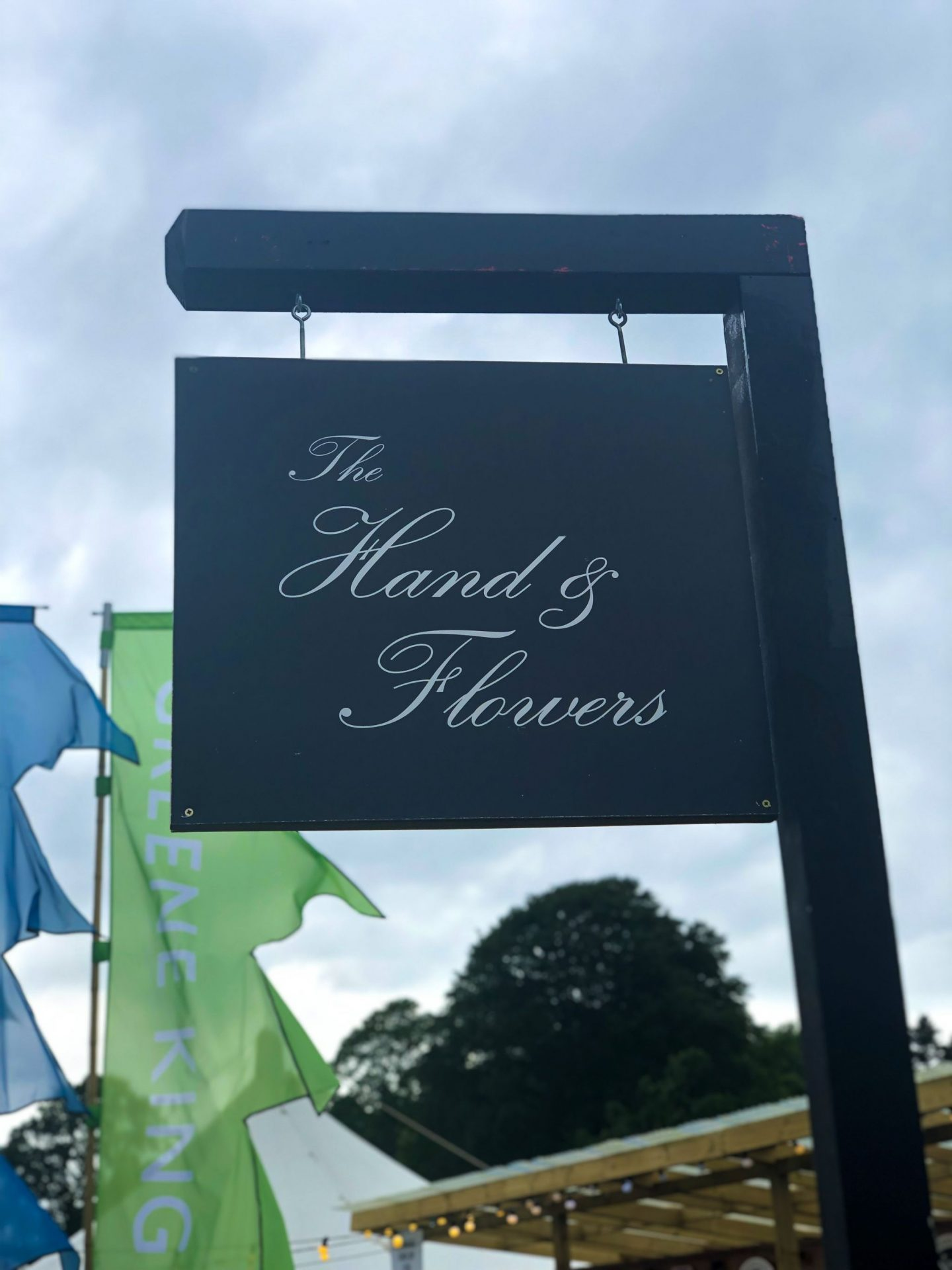 A sign showing the hand & flowers at Pub in the Park in Roundhay park, Leeds