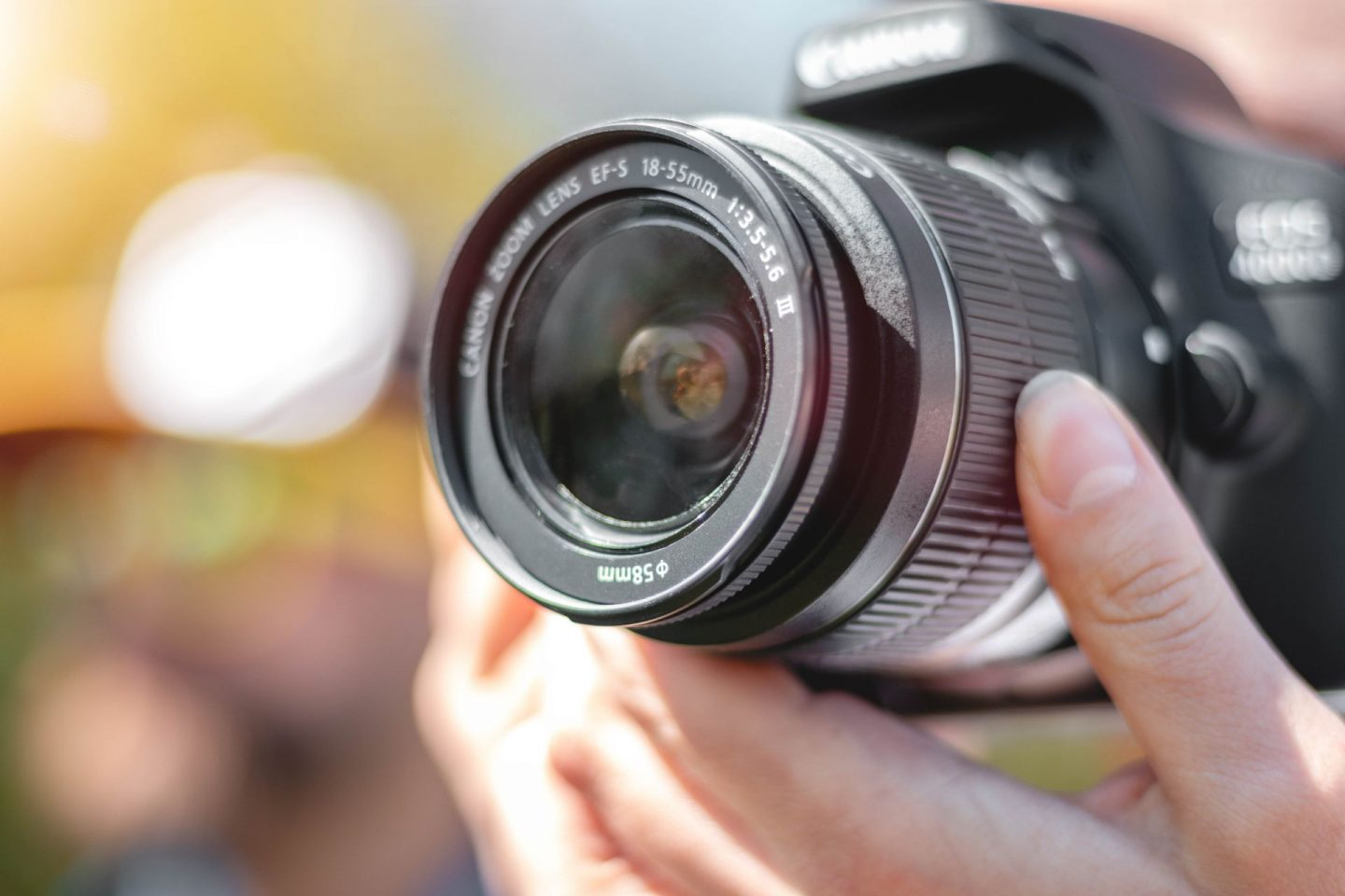 things to do in leeds city centre - image of a camera lens being held in daylight