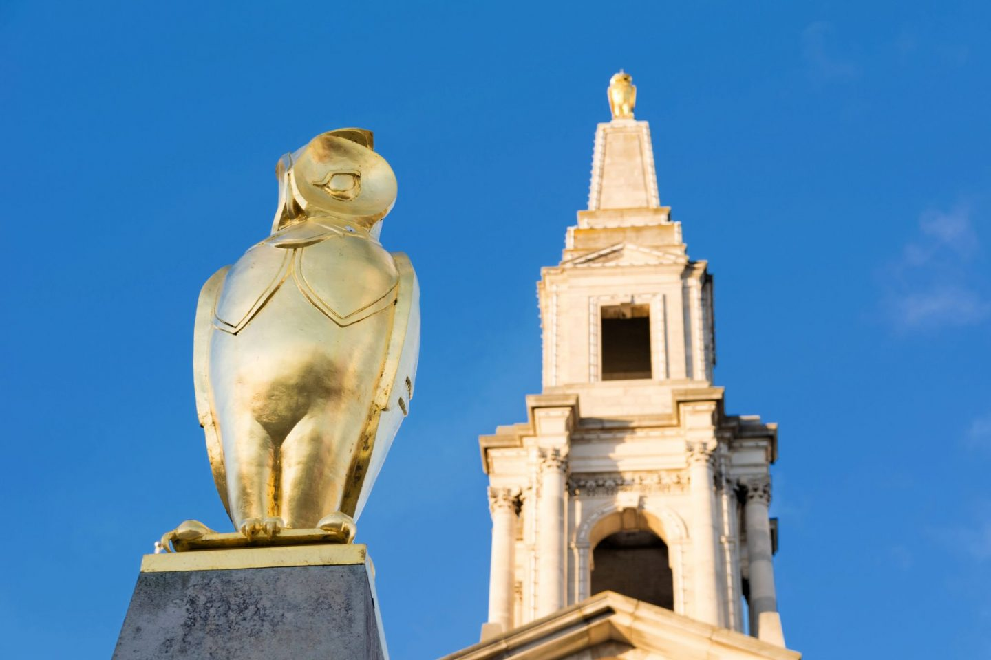 A golden owl statue against a bright blue sky, things to do in Leeds
