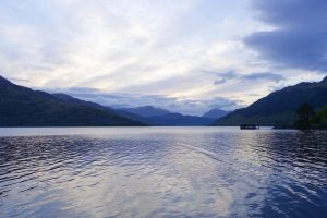 walking the west highland way, accommodation: evening view over a blue lake with mountains in the background