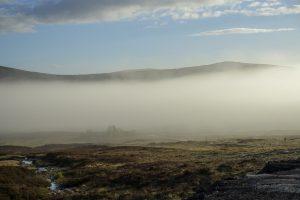 walking the west highland way accommodation: Morning mist over the Scottish Highlands at Glencoe Mountain Resort