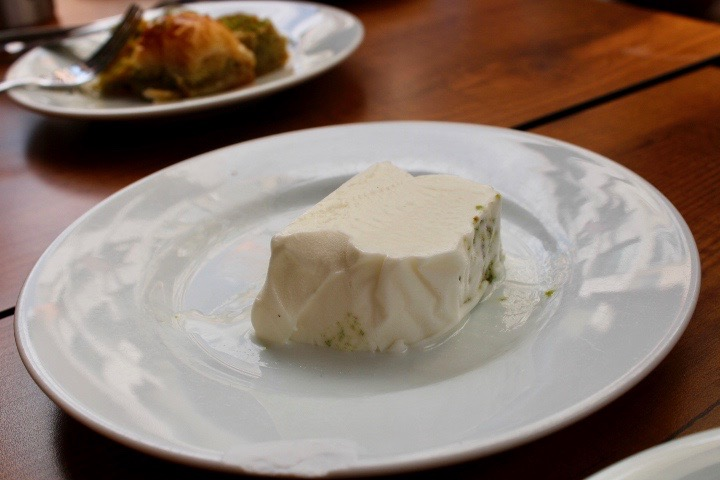Turkish ice cream on a white plate, served as a rectangular block.