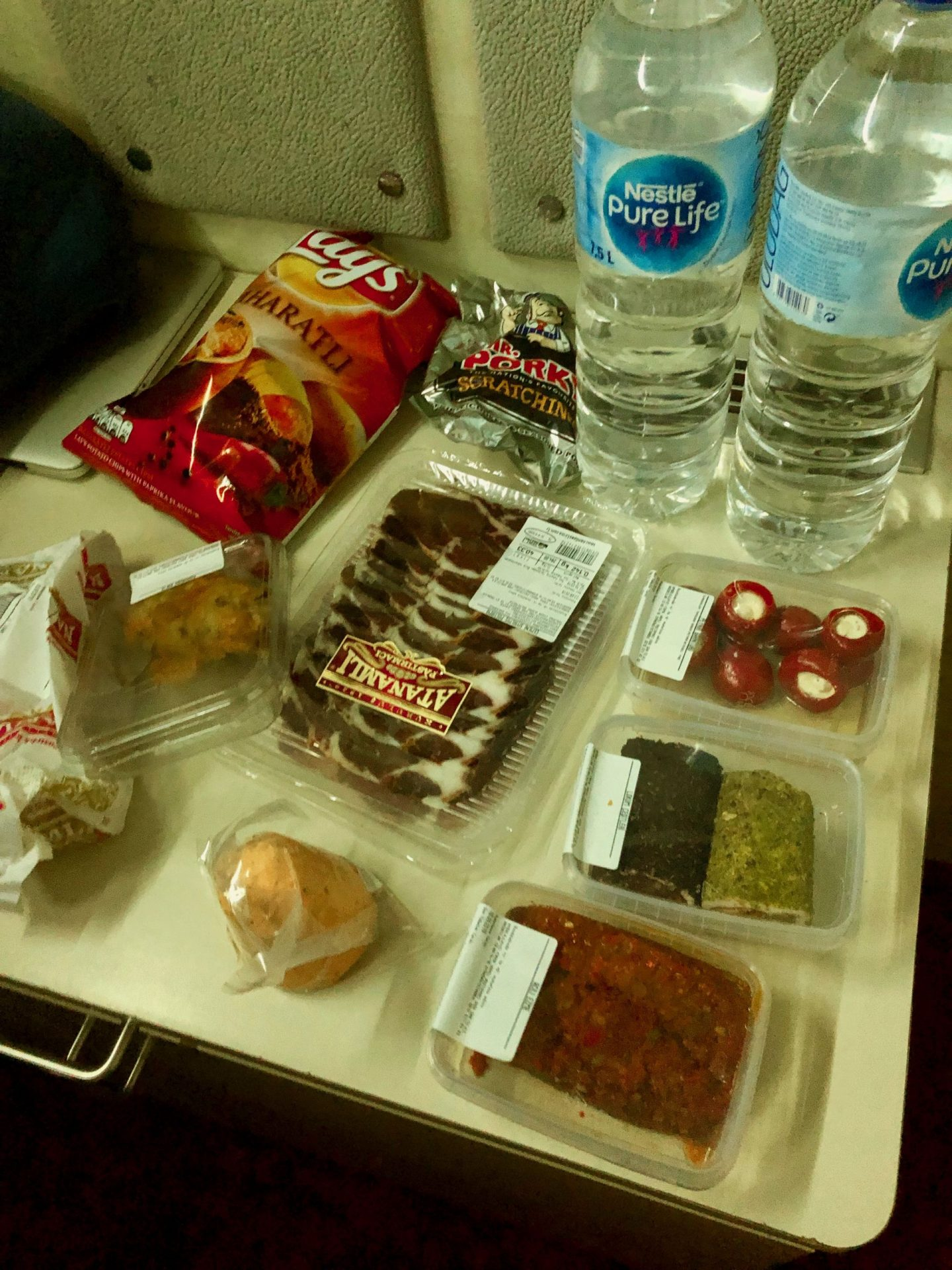 A picture of our picnic on the Istanbul to Sofia night train consisting of dried meat, cheese, mezze, crisps and water