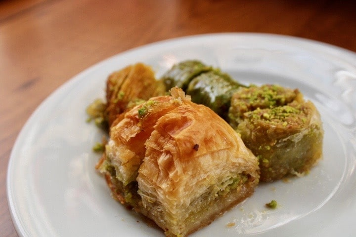 Turkish food in Istanbul: A close up of some bakalava eaten in Istanbul with flaky pastry and pistachio.