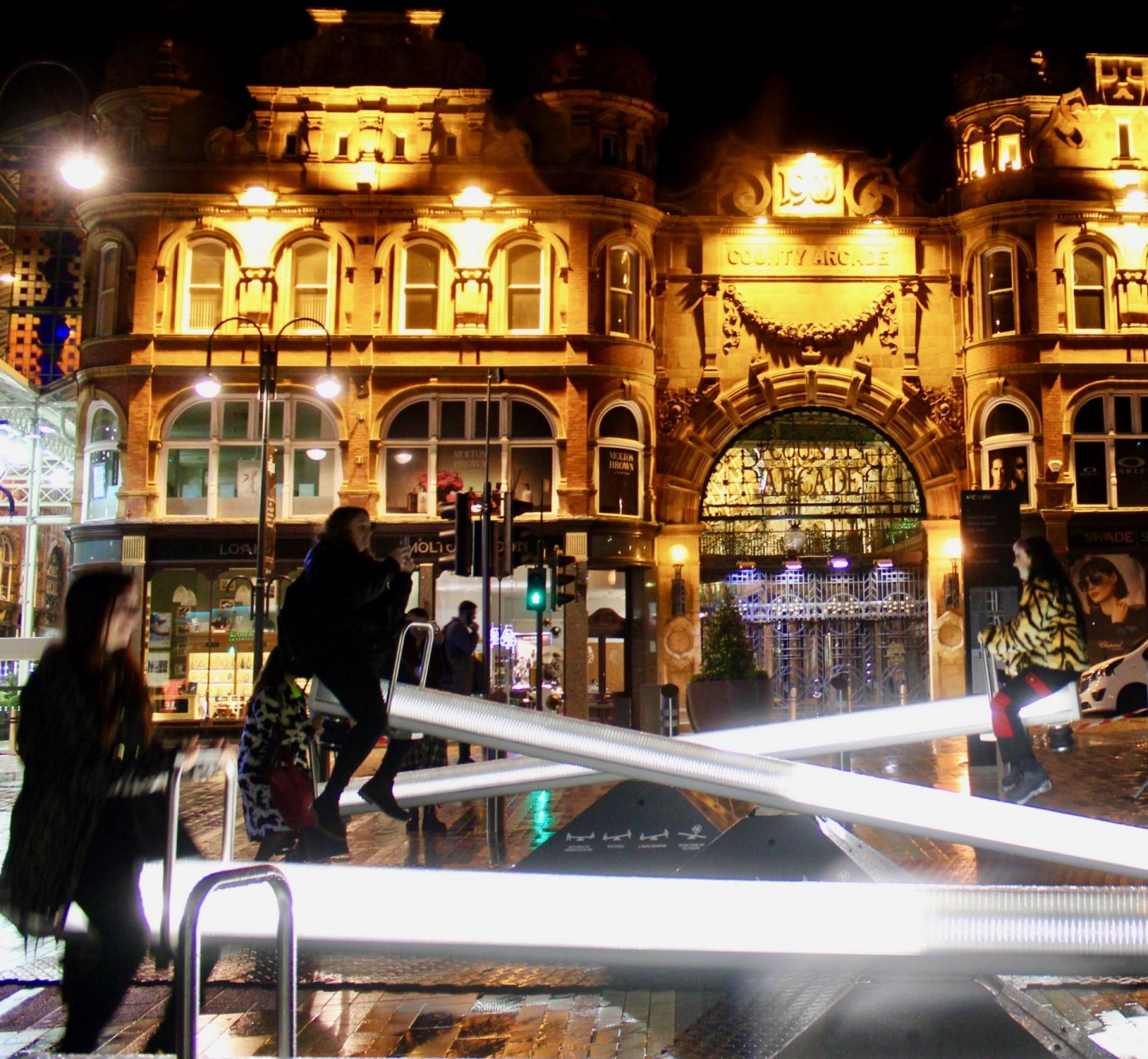 Illuminated seesaws in action, in front of the County Arcade in Leeds at Leeds Light Night