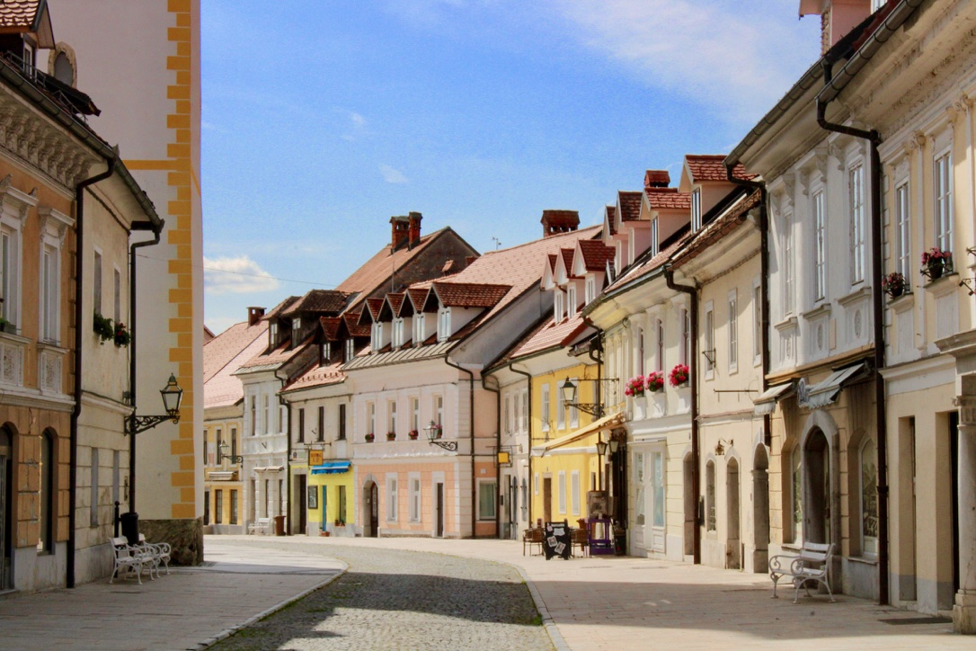 Shot of the colourful main street of Kamnik, with cobbled road and no one around