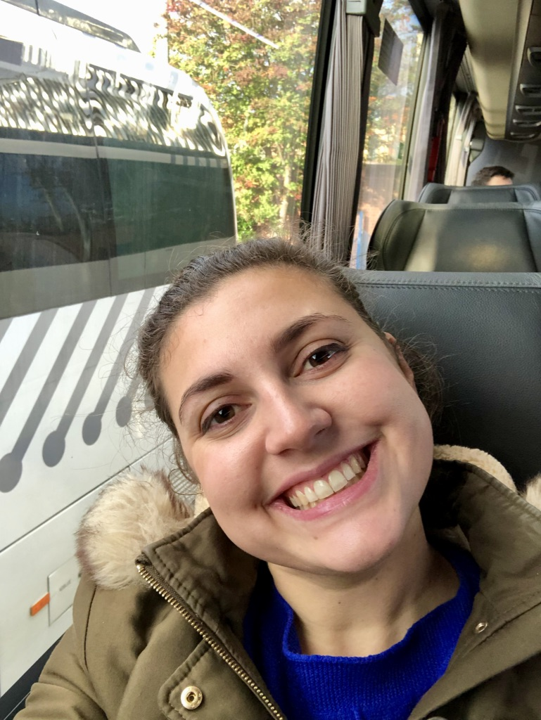 Nell sat on a National Express coach on route to Liverpool, looking happy and comfortable