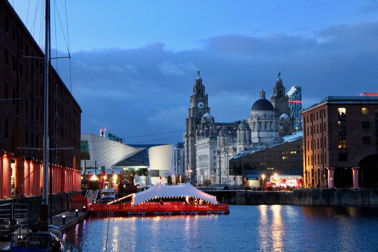 Best things to do in Liverpool: St Alberts Dock in the evening, with lights reflecting off the water