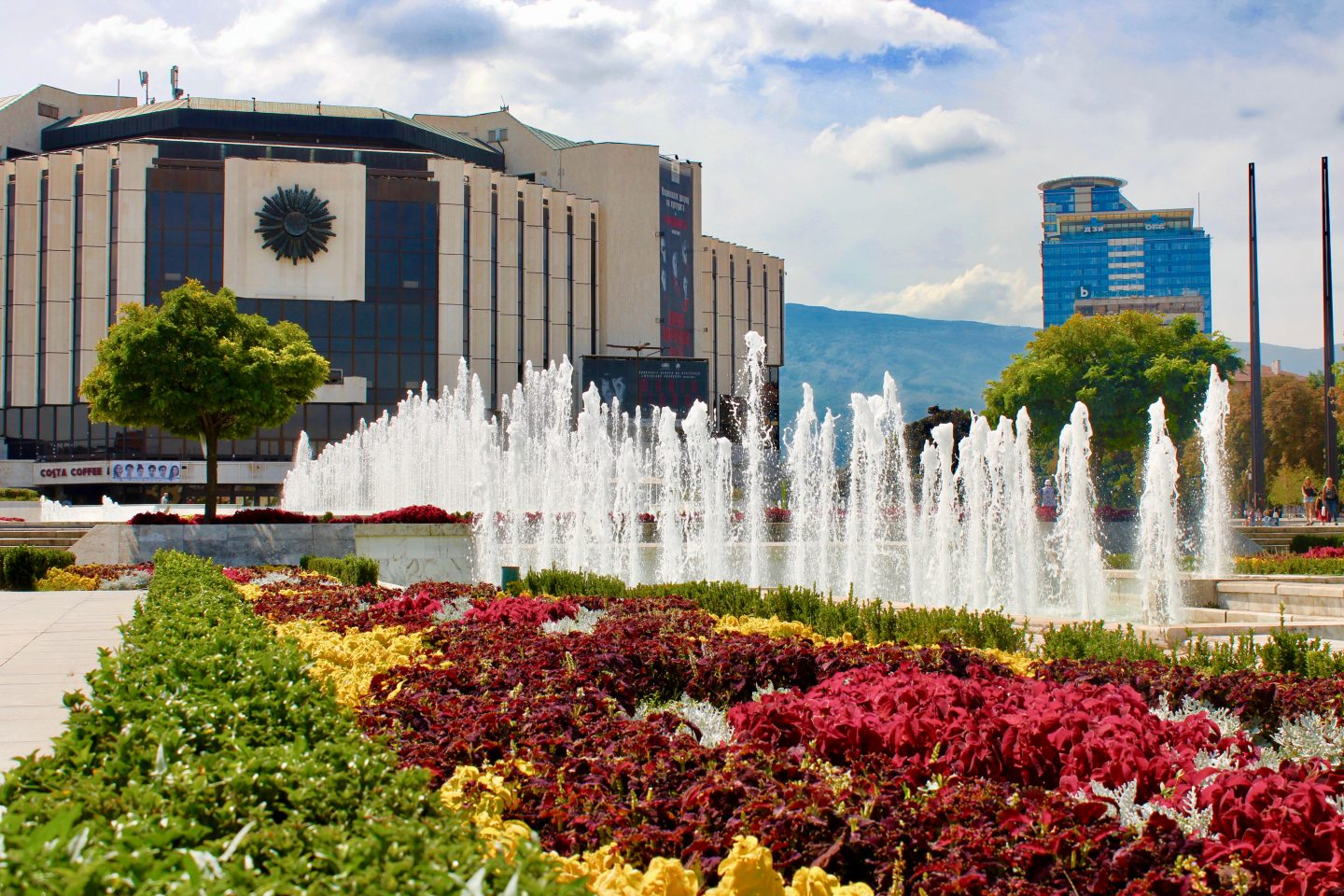 sofia city break: A park in Sofia, showing colourful flowers with fountains behind