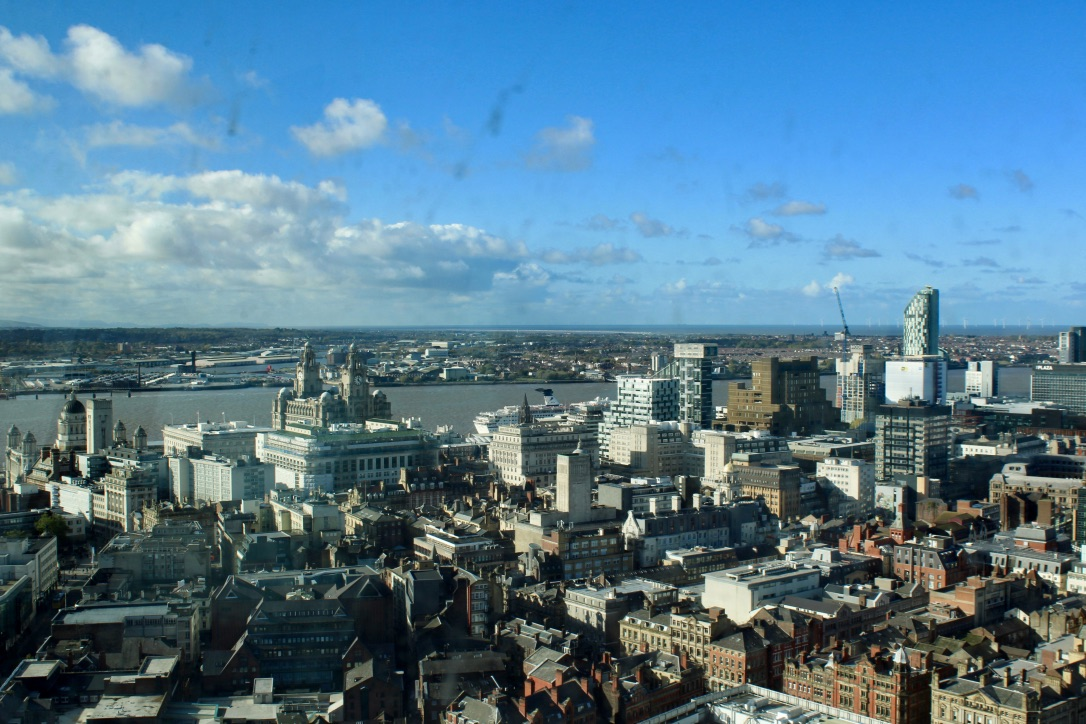 The view from the top of St John's Beacon in Liverpool, looking out over the Liver building and the river Mersey.