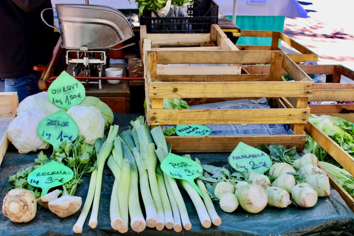 24 hours in Ljubljana food & wine: A market in Ljubljana showing green vegetables next to a wooden crate