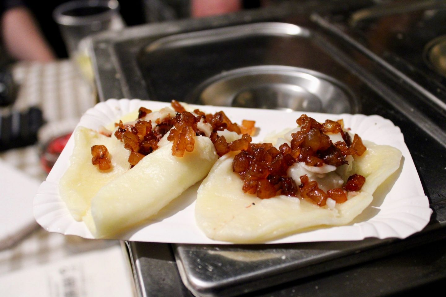 24 hours in Ljubljana food & wine: dumplings on a paper plate at Open Kitchen
