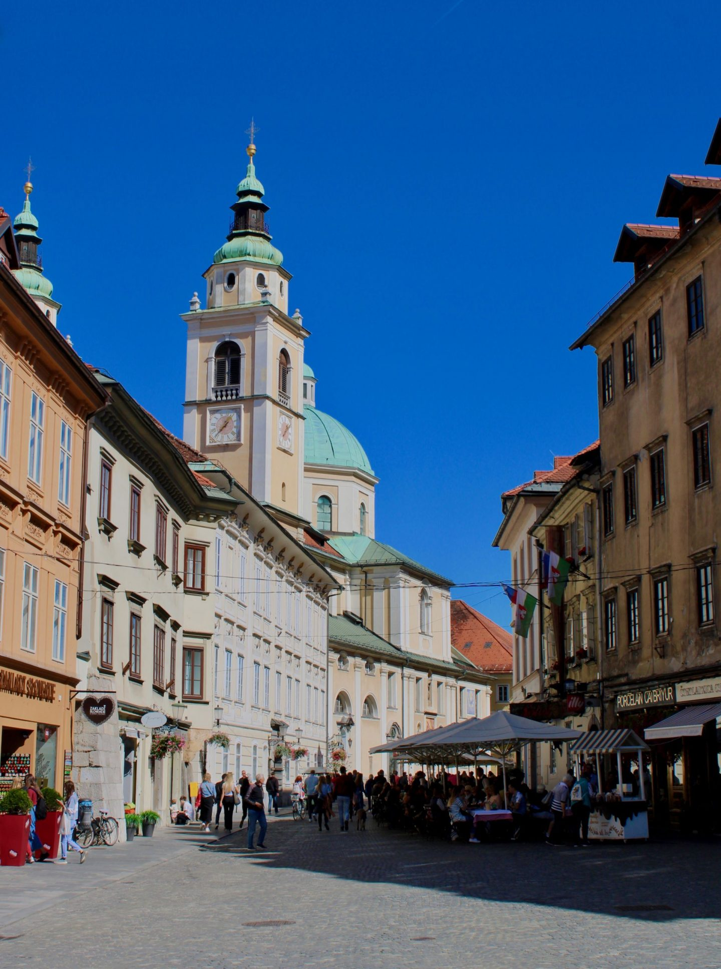 24 hours in Ljubljana food & wine: a street in Ljubljana with a blue sky behind