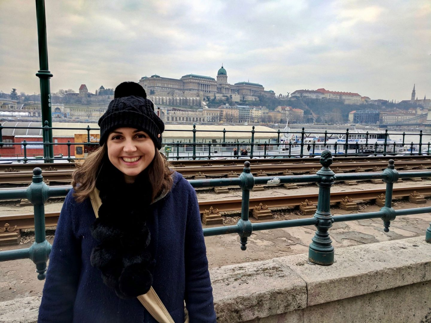 Nell smiling at the camera on a bridge - things to do in Budapest