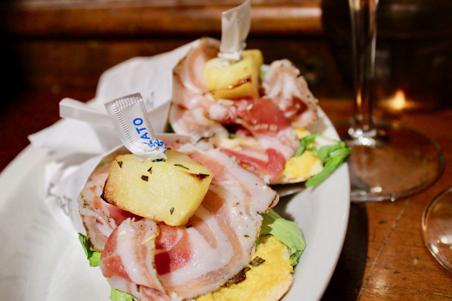 best cicchetti in Venice: bread topped with ham and a roast potato