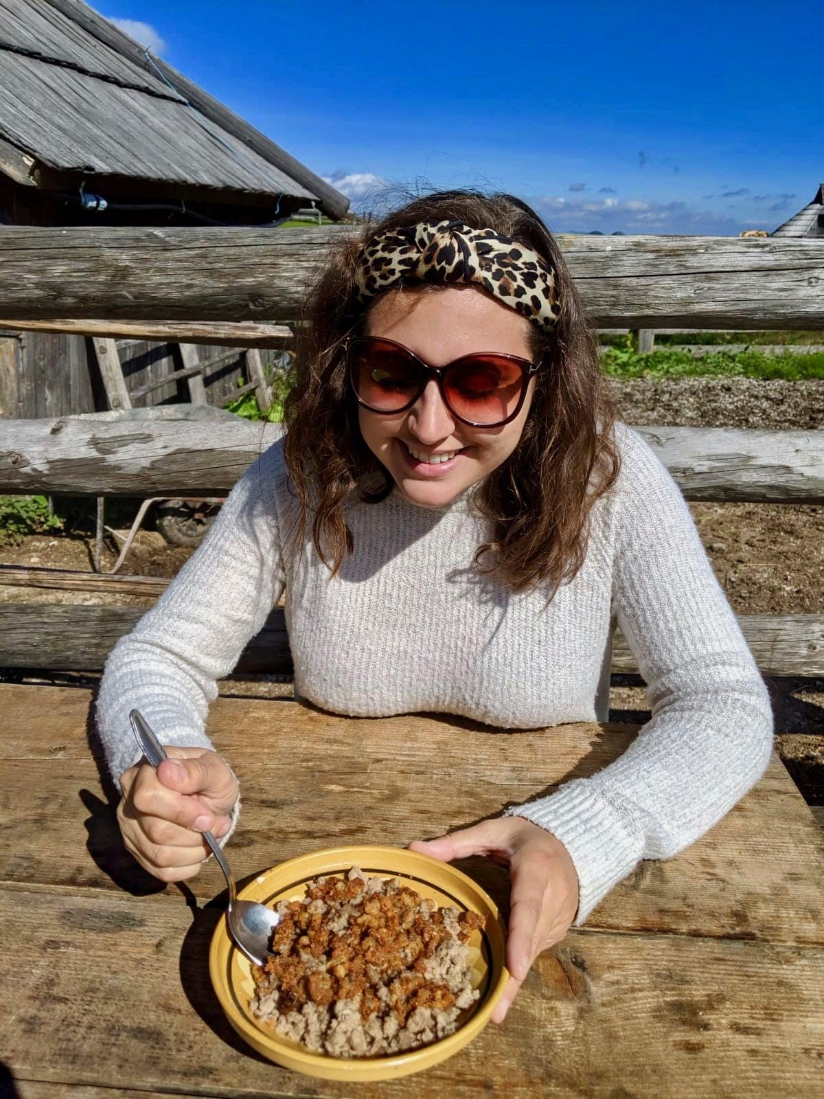 Kamnik and Velika Planina: Nell eating traditional buckwheat mush in Velika planina