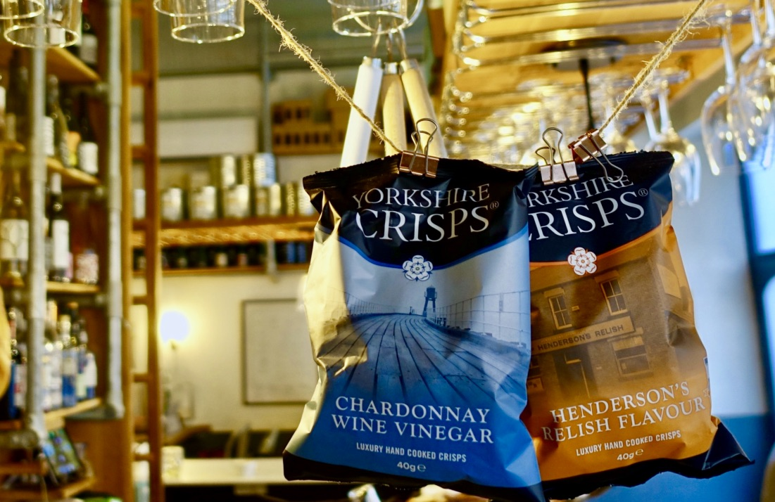Yorkshire crisps hanging by string in a pub