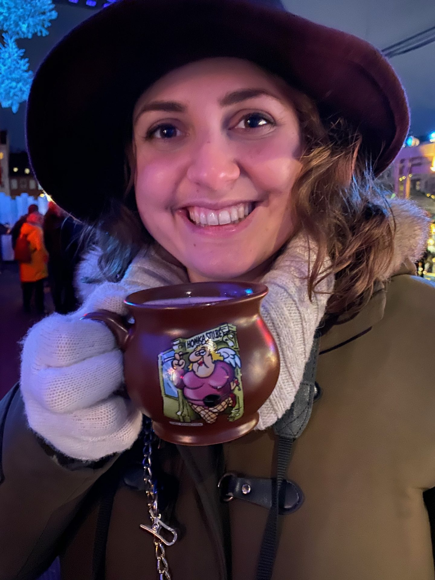 Hamburg Christmas markets santa pauli: Nell holding a mug of mulled wine and smiling at the camera at the Santa Pauli Christmas market in Hamburg