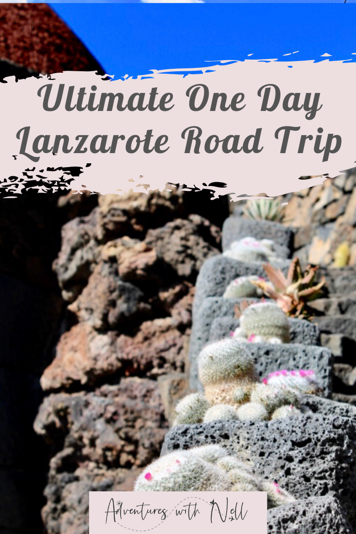 Pinterest graphic showing image of steps with a variety of cacti at the side and a very bright blue sky. Across the top is text saying ultimate one day lanzarote road trip