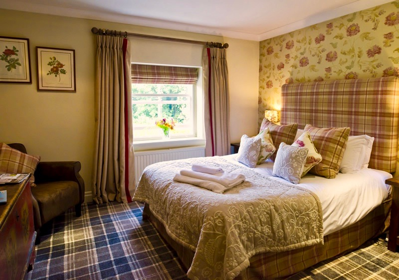 The Pheasant Hotel Harome: inside the Blakey Suite showing a comfortable looking bed