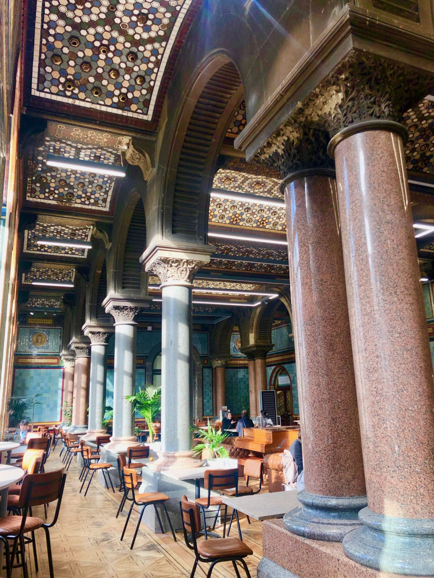 Coffee Shops Leeds - Tiled Hall with columns, a tiled ceiling and plenty of seating