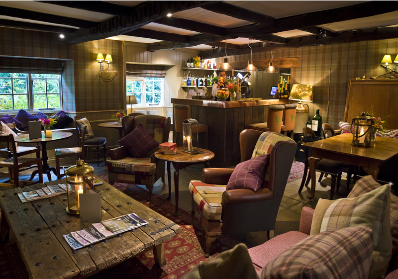 The Pheasant Hotel Harome: the cosy bar area complete with beams and low ceilings