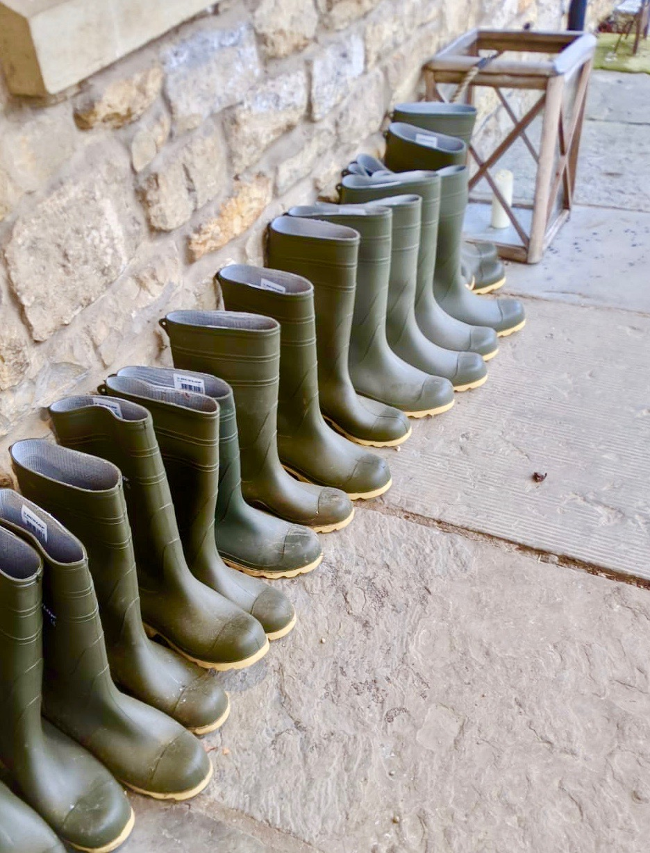 A line up of green wellies outside the pheasant hotel harome