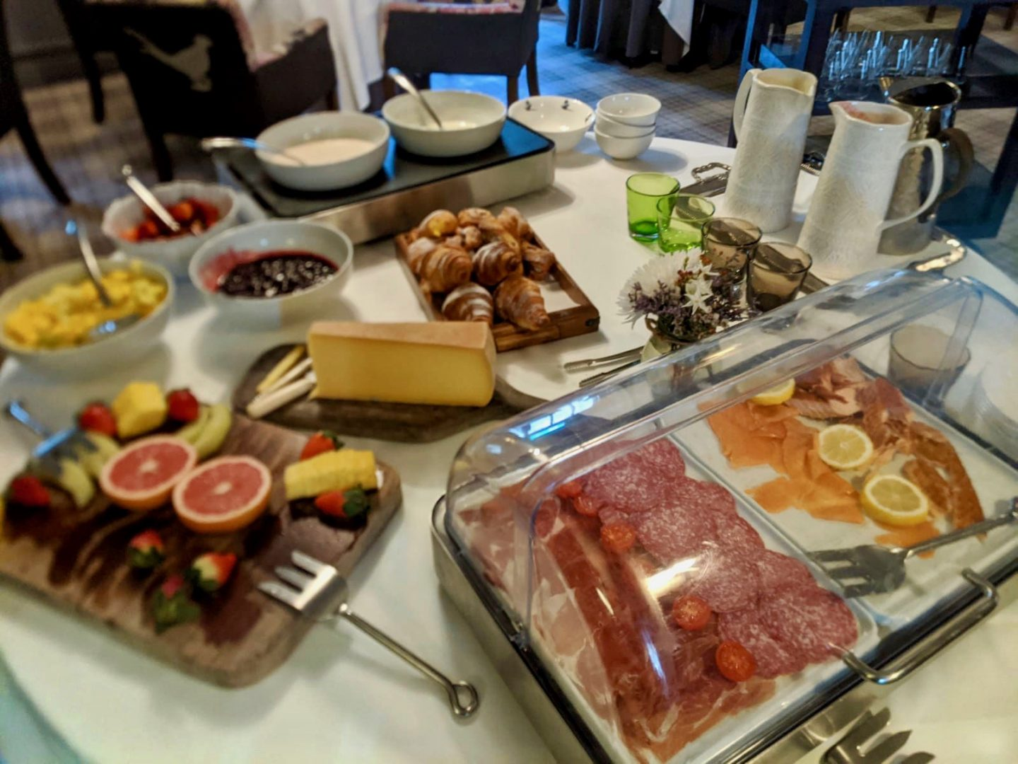 The pheasant hotel harome: breakfast buffet with hams, cheeses, fruit, pastries and juice