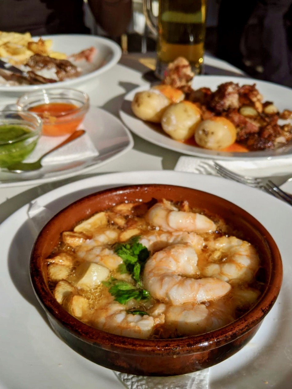 best tapas restaurants playa blanca lanzarote - garlic prawns, with potatoes and mojo in the background