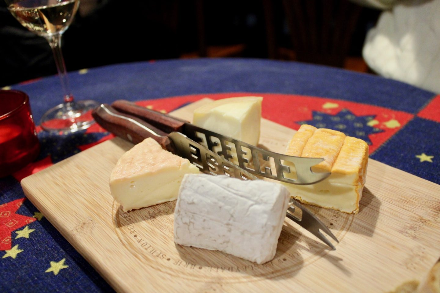 best bars in wroclaw, wine bars in Wroclaw, cheese board with 4 large blocks of cheese and a cheese knife