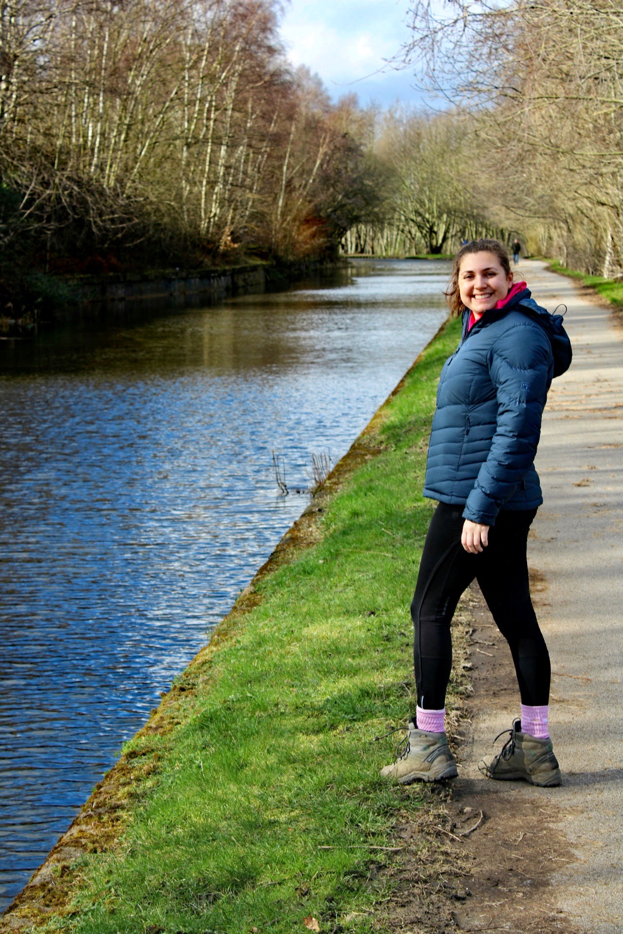 mental health during coronavirus - blogger Nell walking along Leeds Liverpool Canal and turning back to face the camera