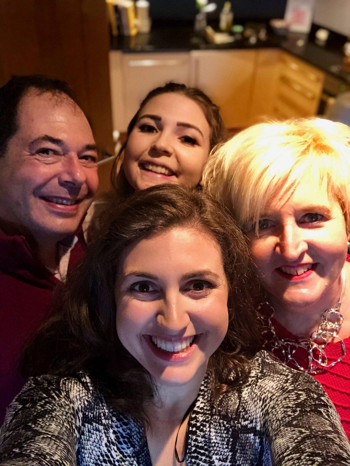 Practising gratitude during coronavirus: A selfie of Nell, her mum, her dad and her sister taken in her kitchen