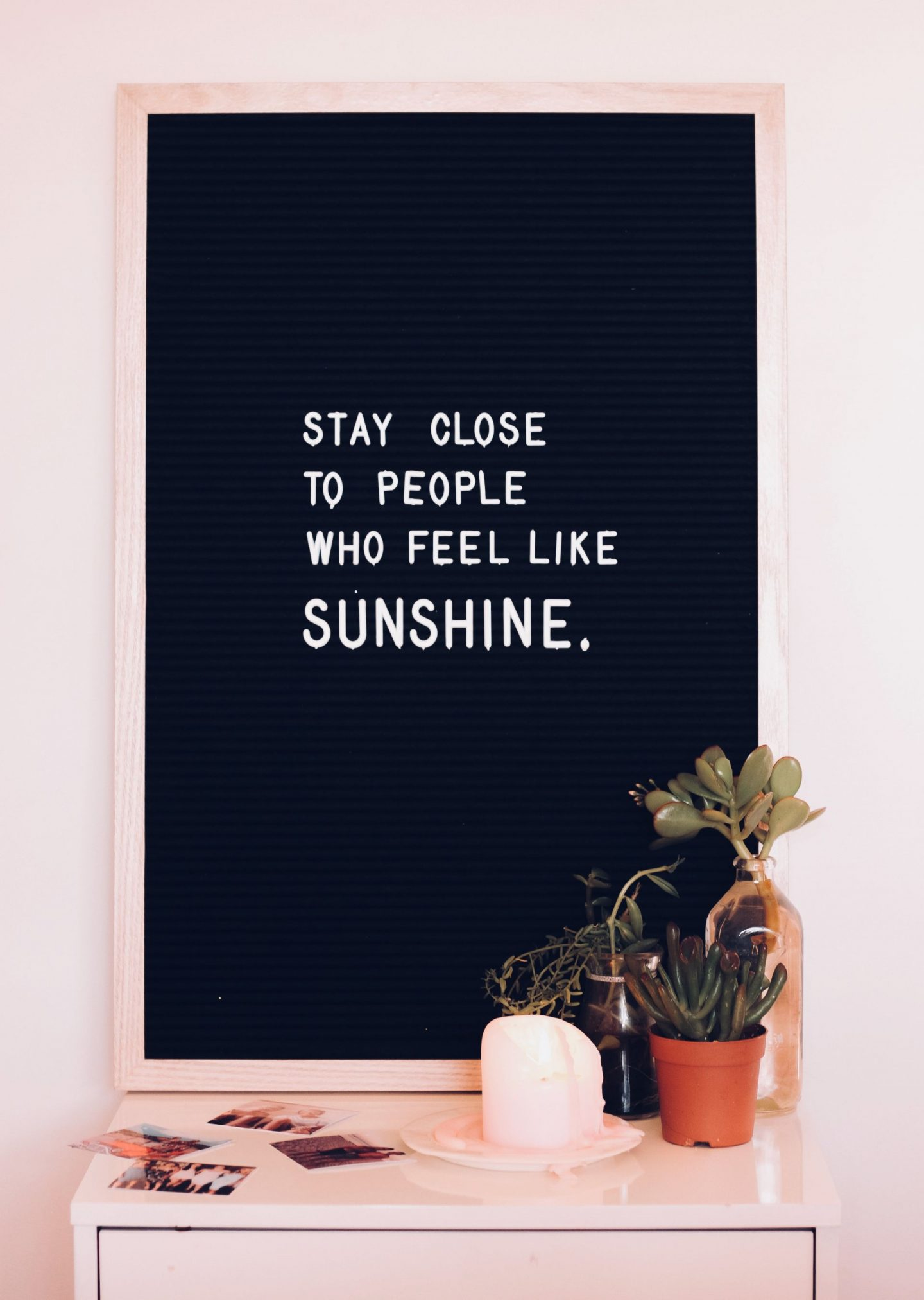 "Staying positive during Coronavirus: a blackboard showing the quote ""stay close to people who feel like sunshine"""