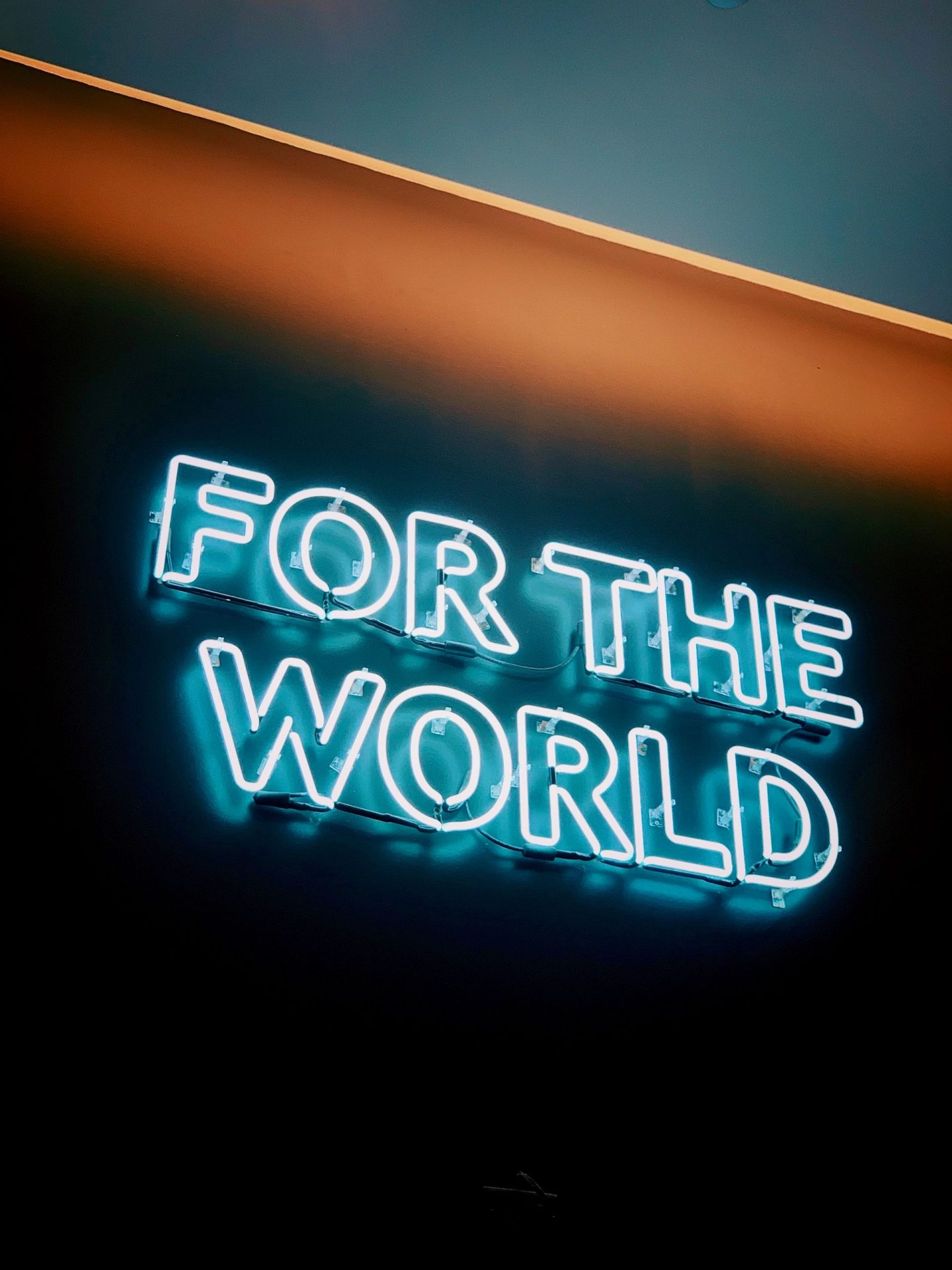 "Staying positive during Coronavirus: ""for the world"" written as a neon sign"