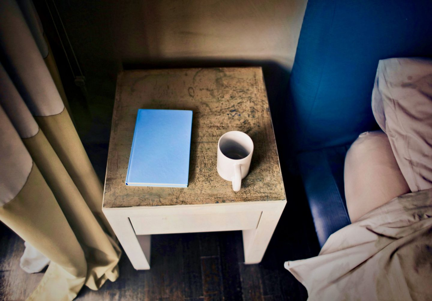 things to do at home when self-isolating bedside table with coffee and a book