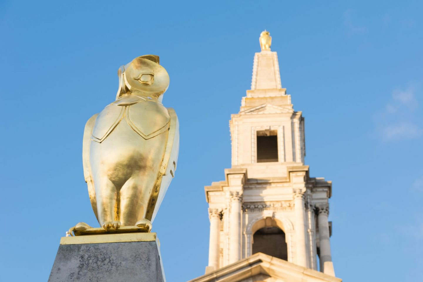 things to do in Leeds city centre - a gold statue of an owl against a clear blue sky