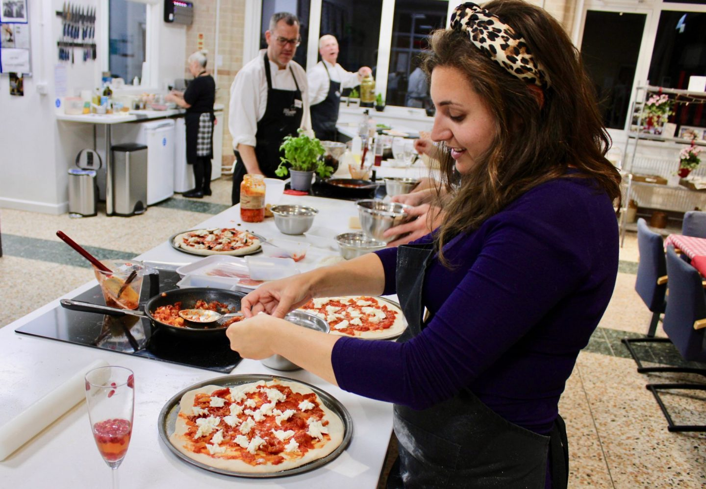 things to do in leeds city centre - nell concentrating on make a pizza at Leeds cookery school