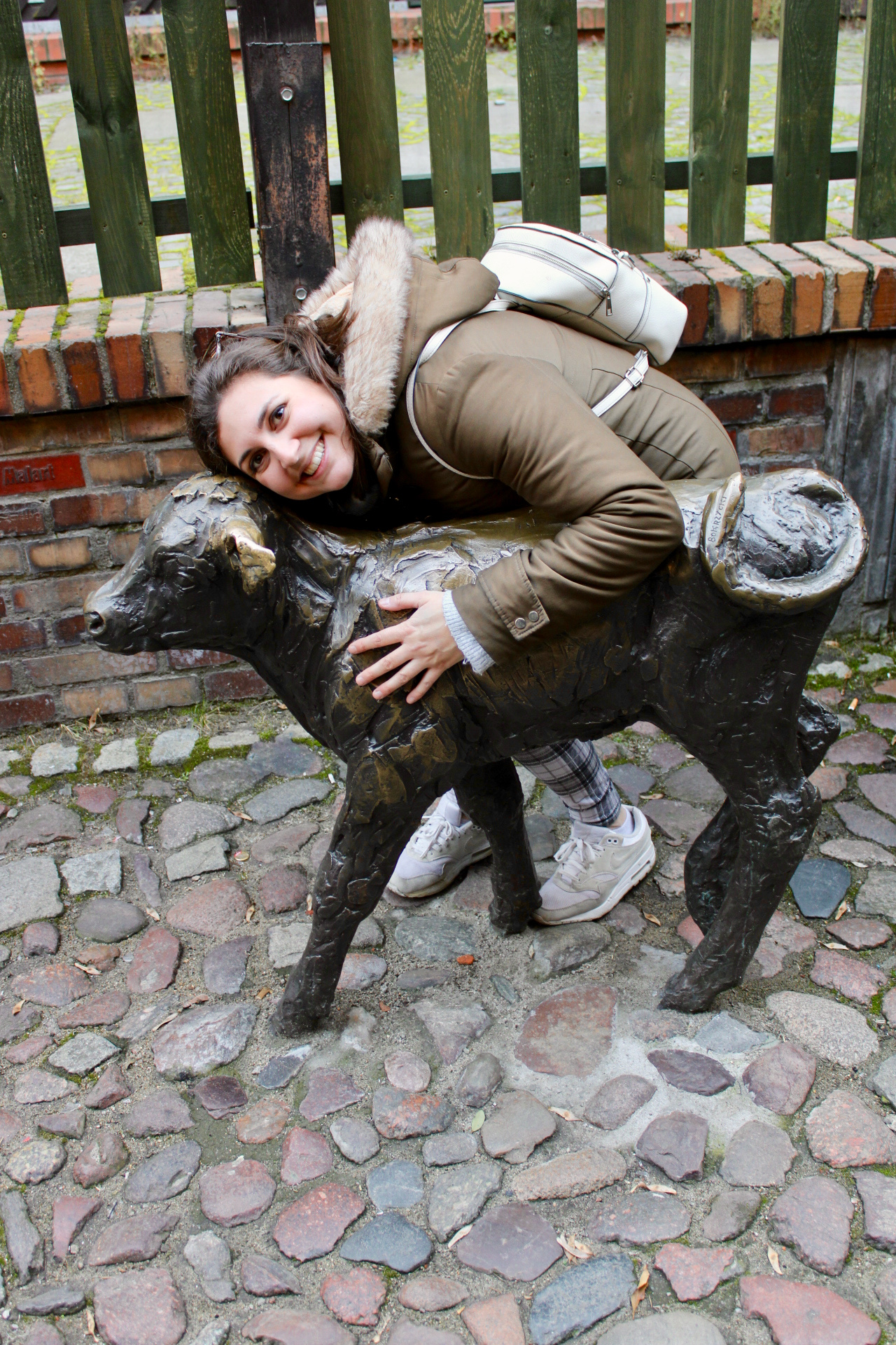 things to do in Wrocław: Nell cuddling a statue of a calf